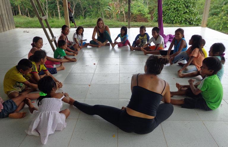 volunteers teaching in the village
