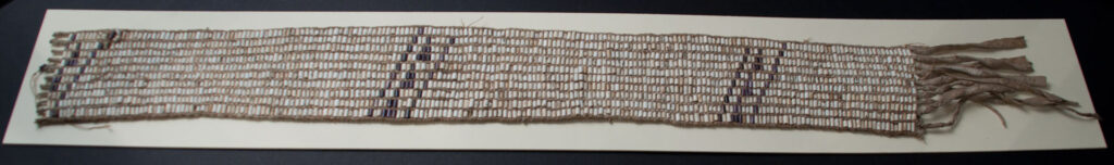 GREENVILLE TREATY WAMPUM BELT OHC Artifact ID#: H50297 Date of Origin: 1795 Composition: Buckskin belt adorned with ten rows of white and black wampum arranged in a diagonal stripe pattern. Significance: This is a wampum belt given by Miami Chief Little Turtle to United States General Anthony Wayne on the occasion of the Treaty of Greenville. Wampum is made from a shellfish found only in the North Atlantic. It was used to adorn items of religious or political importance. The patterns formed by the shells can even encode messages. Wampum belts were often sent by couriers as a message of war or peace among the tribes. They were often exchanged at treaty negotiations to solemnize the agreements. The Treaty of Greenville established a firm border for the future State of Ohio, while preserving a corner of the state for Indian use. It ended a period of warfare that had lasted for ten years and laid the foundation for white settlement in the Midwestern states. General Wayne died in 1796 at Erie, Pennsylvania. Little Turtle passed away near Fort Wayne Indiana, only four days before the War of 1812 was declared.