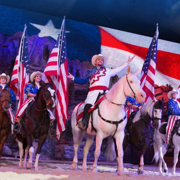 people on horses with american flags