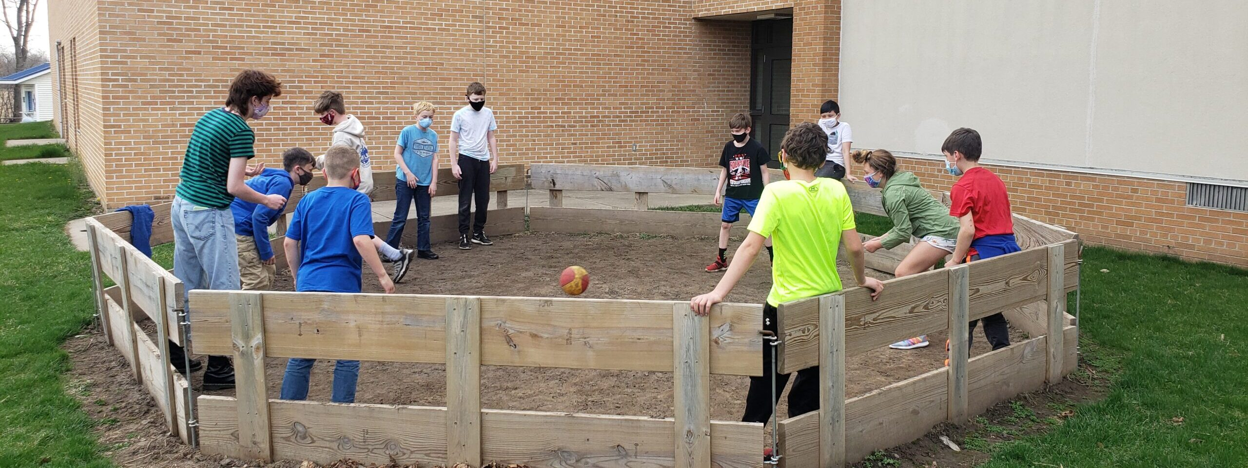 kids playing with a ball in the arena