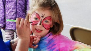 girl getting face paint