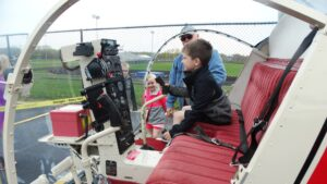 kid in helicopter seat