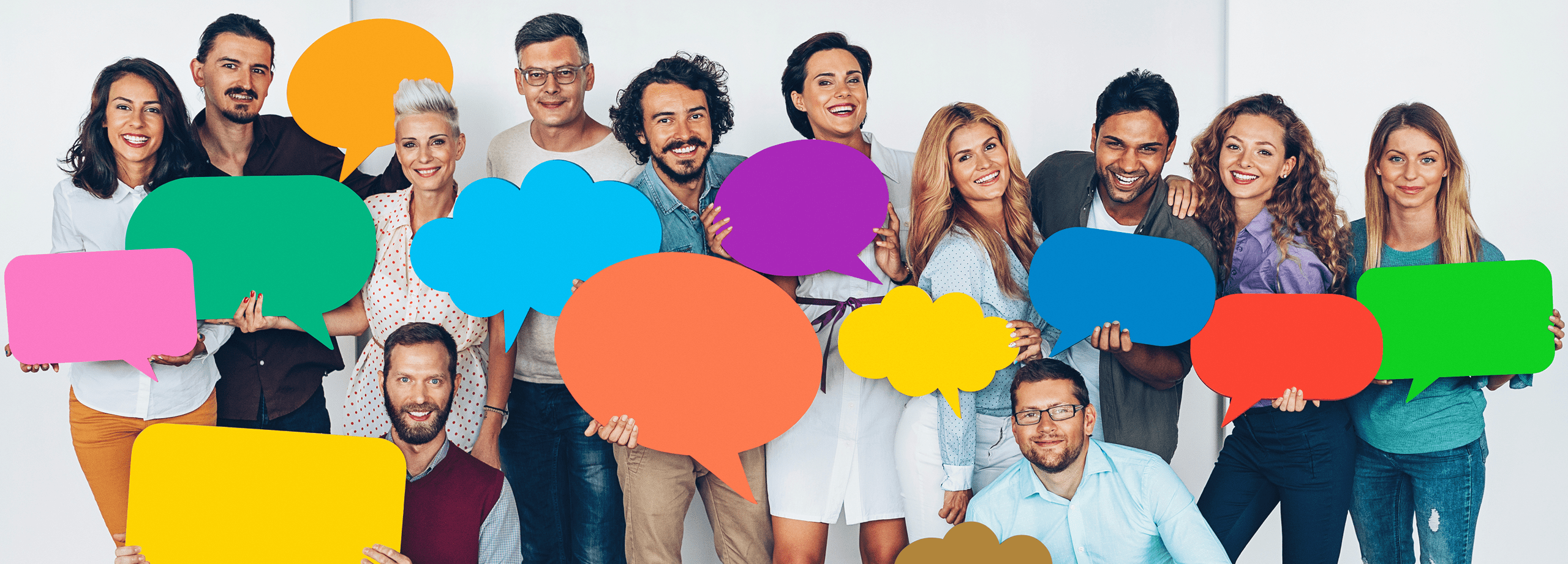 Photo of a group of adults holding speech bubbles to indicate