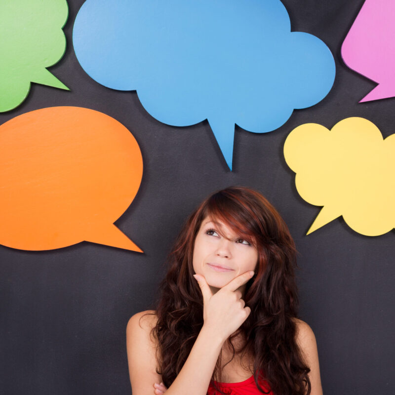 Photo of a young woman with speech bubble above her head