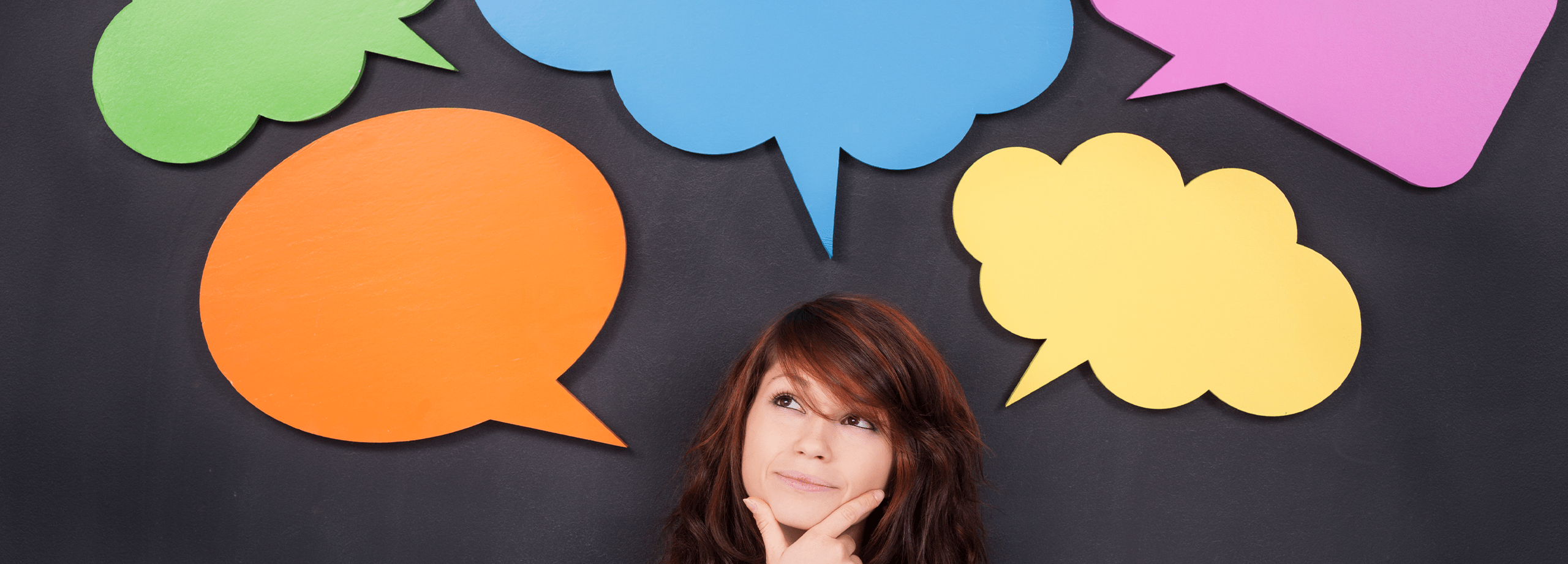 Photo of a young woman with speech bubbles above her head