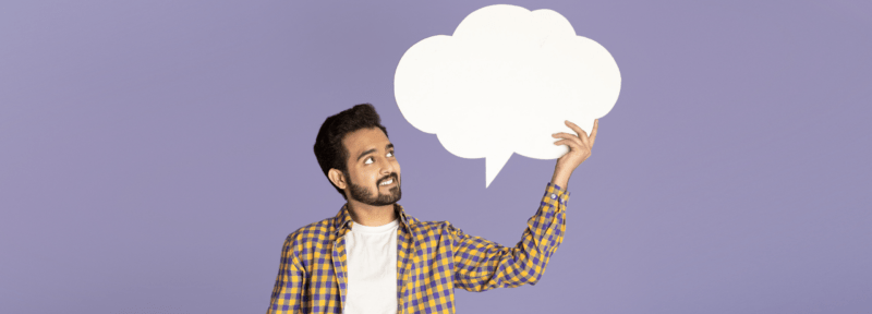 Photo of a man holding a speech bubble