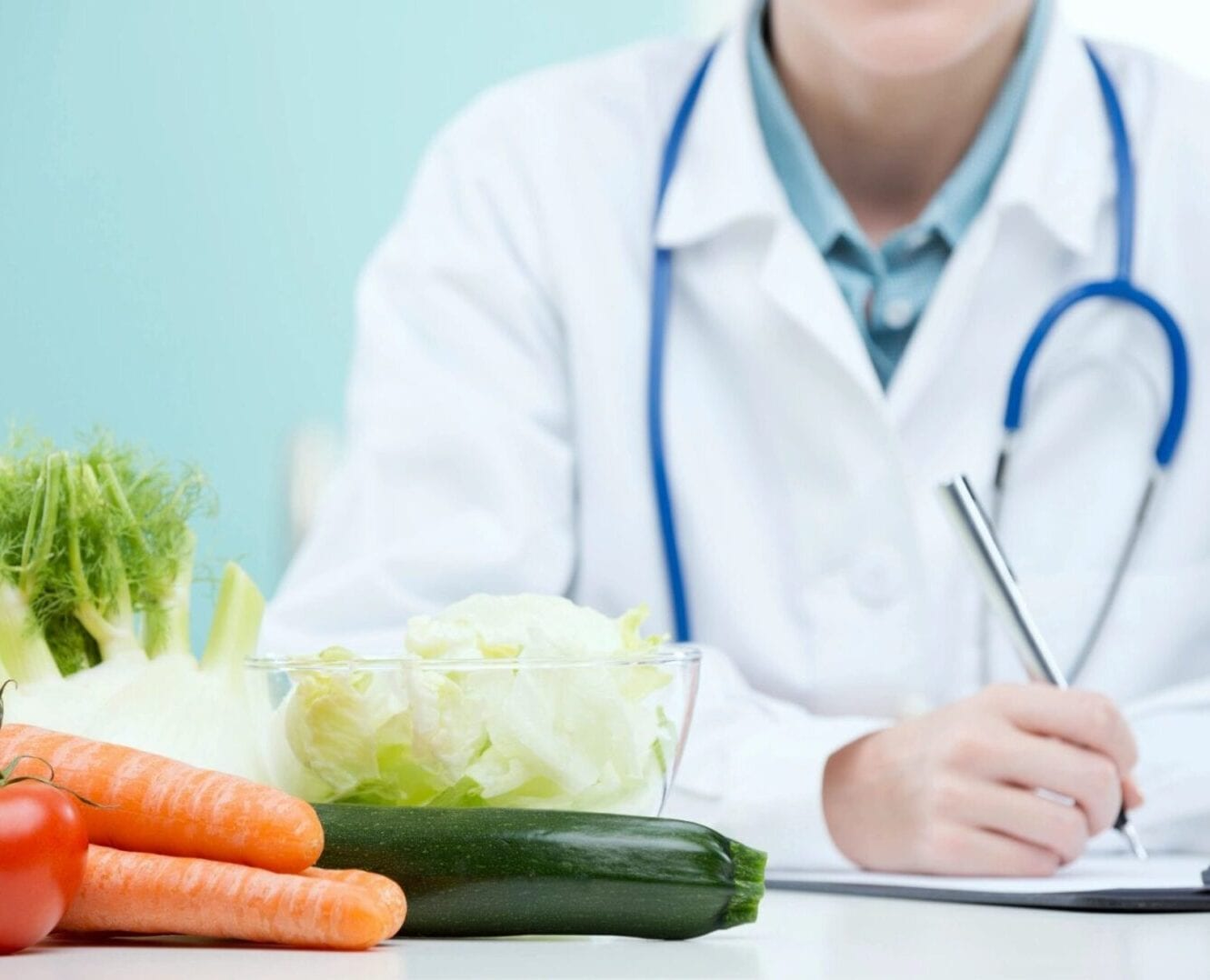 Doctor holding up a pen with vegetables
