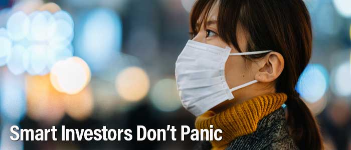 Woman out in public with surgical mask. Smart investors don't panic