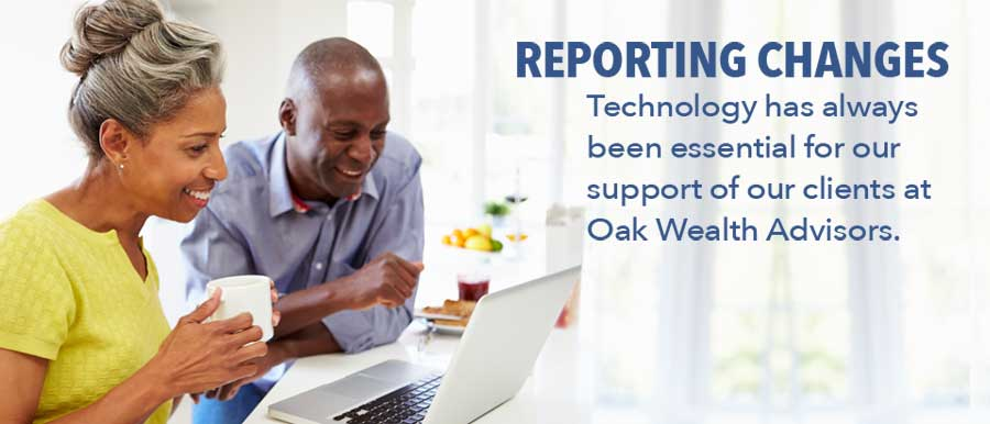 reporting changes with clients at Oak Wealth Advisors photo of couple at computer