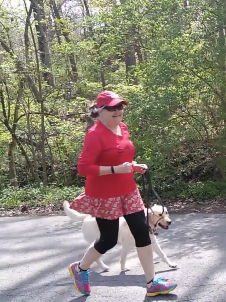 Nita Sweeney running with her dog Scarlet in Jason Didner's music video Run With My Troubles