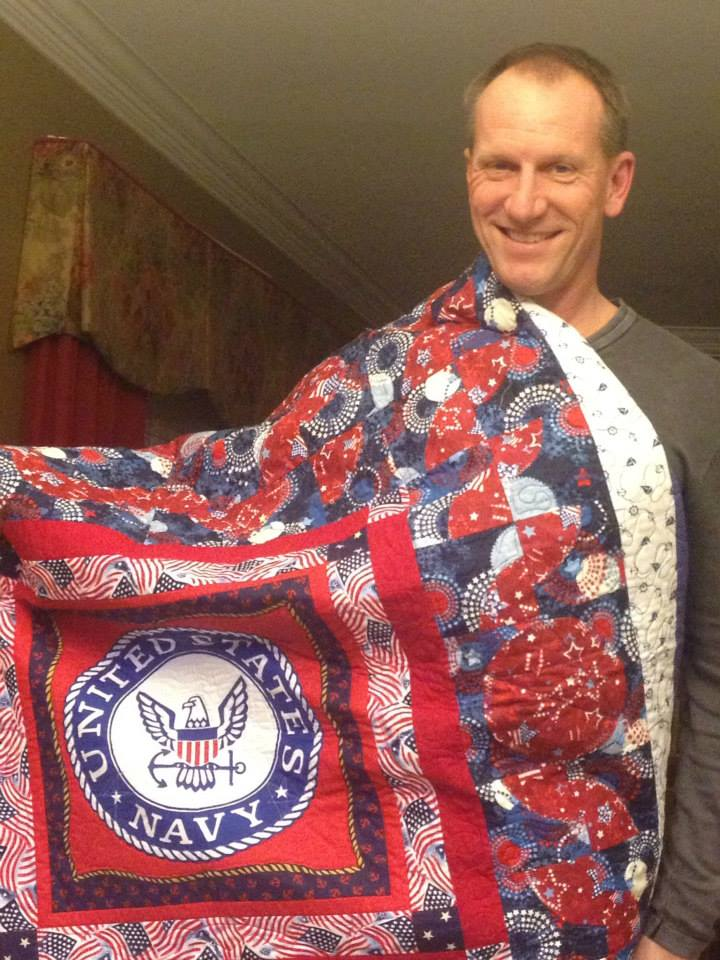 Captain Troy Osten with his Quilt of Valor