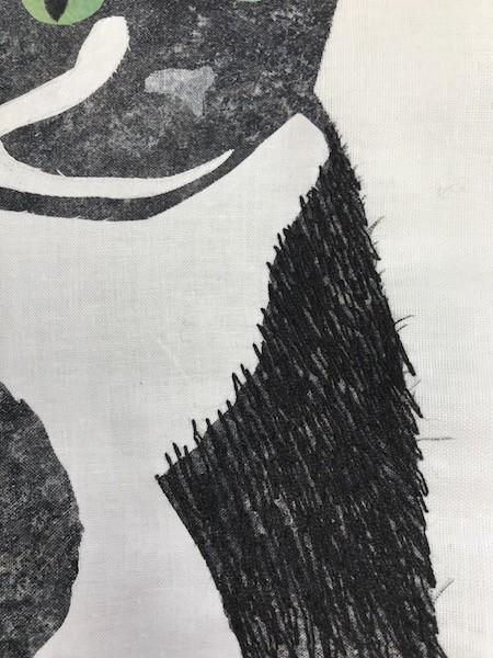 fluffy kitty black stitching lines