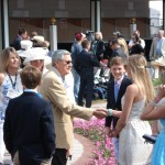 Derby winning trainer Carl Nafzger shaking hands in the paddock