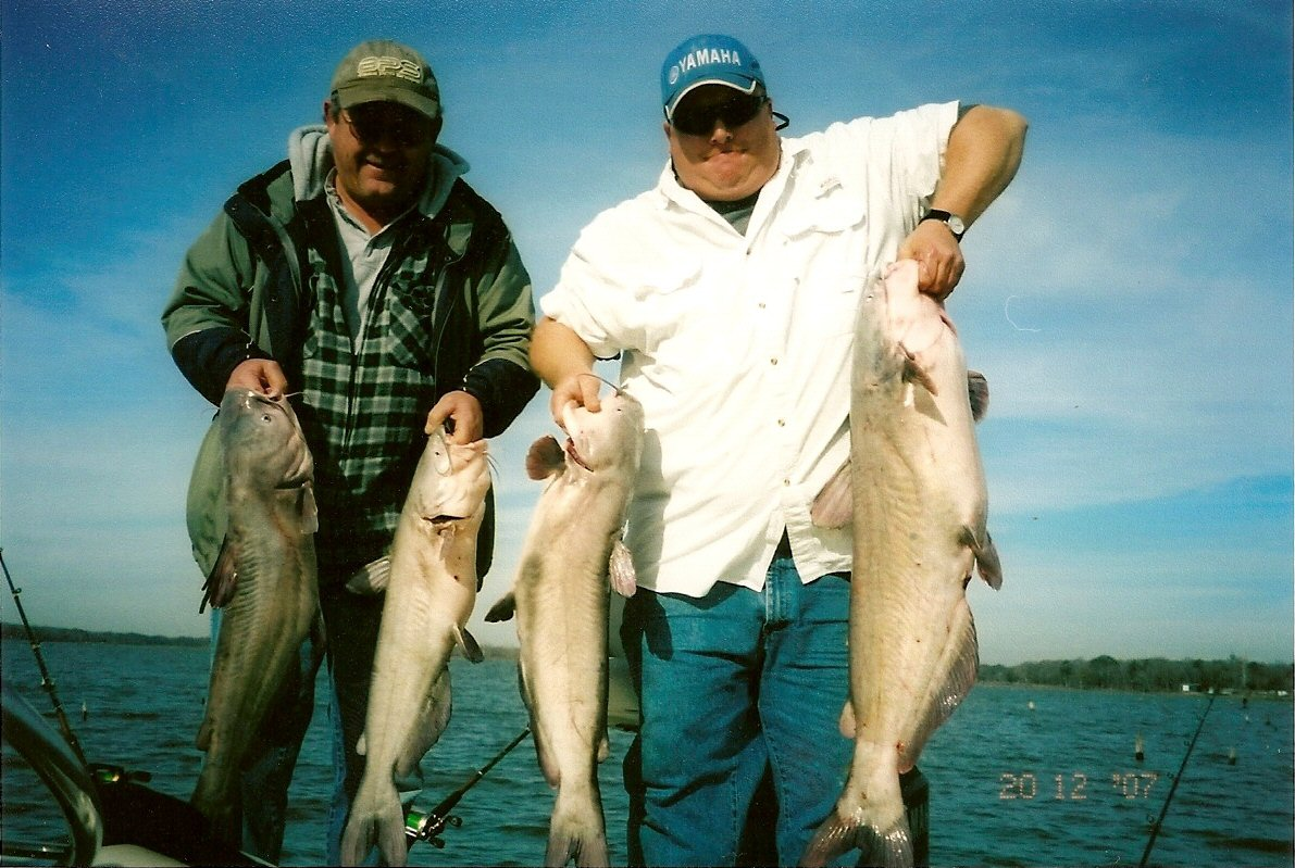 Two men each holding two large fish caught in Lake Limestone TX
