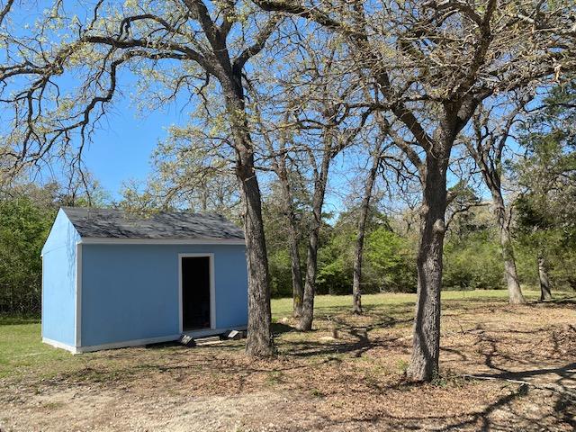 Light blue cabin outside front
