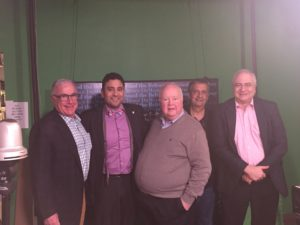 Bruce Dumont (center) with recent guests Michael Bauer, Khalil Marrar, Ray Hanania and Charles Lipson. Photo courtesy of Aaron Hanania