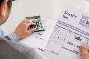 best-energy-practices-with-your-hvac - looking at bills