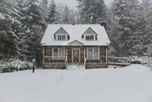 House covered in snow during winter.