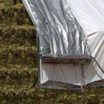 Top tarp on hay stack