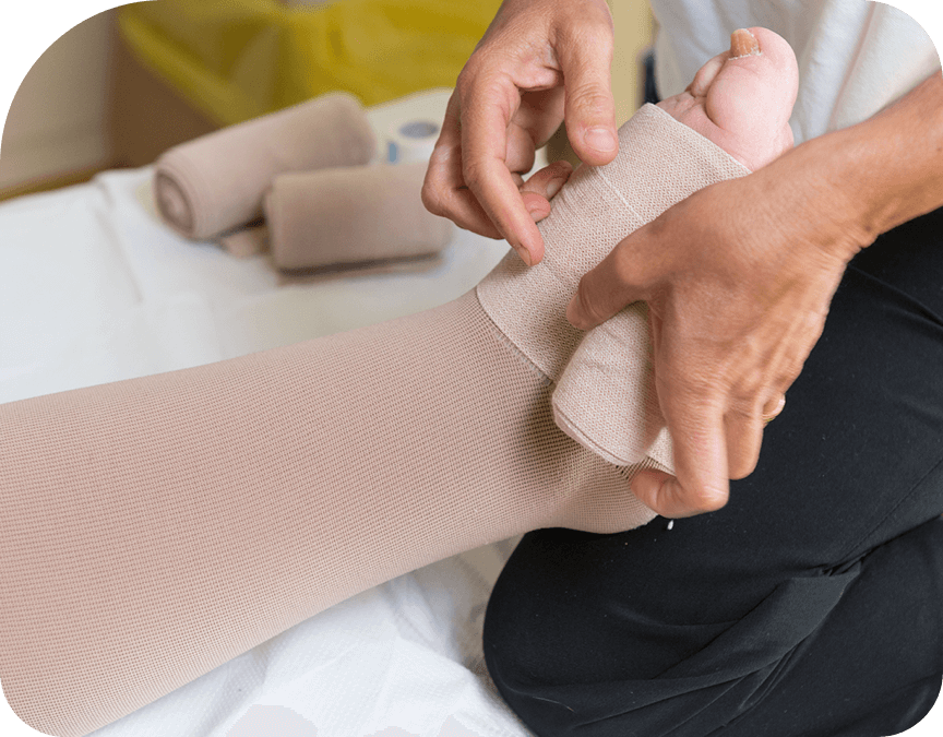 Healthcare worker helping patient with compression stockings