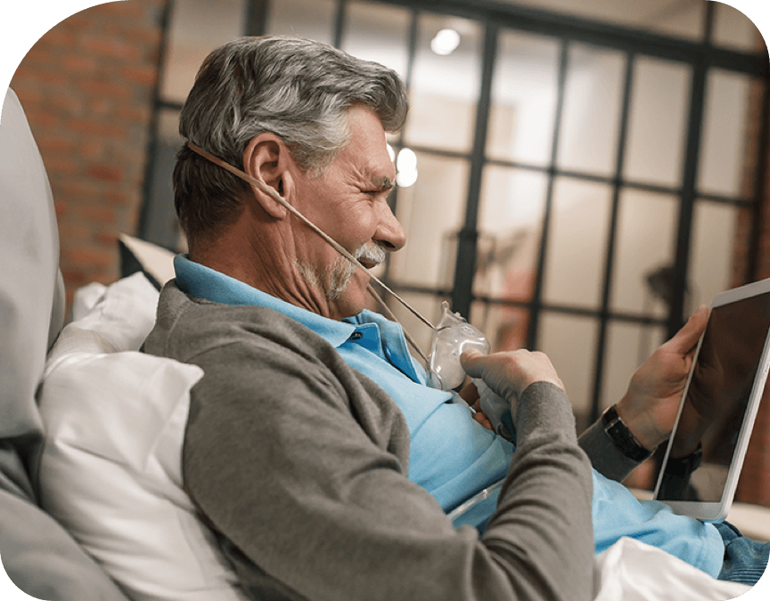 Man using home oxygen and respiratory equipment