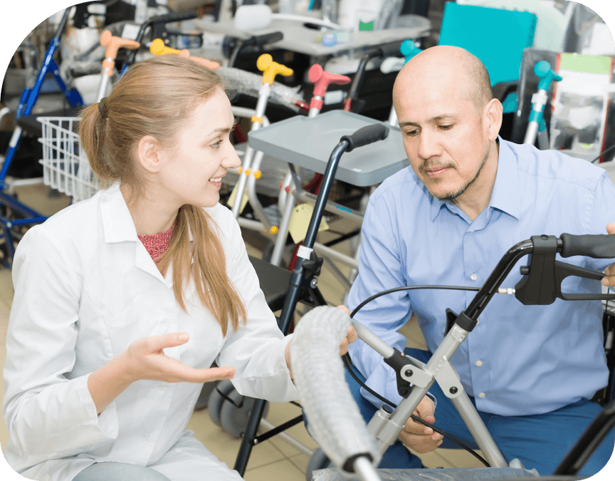 Woman helping man with medical equipment rental and loan