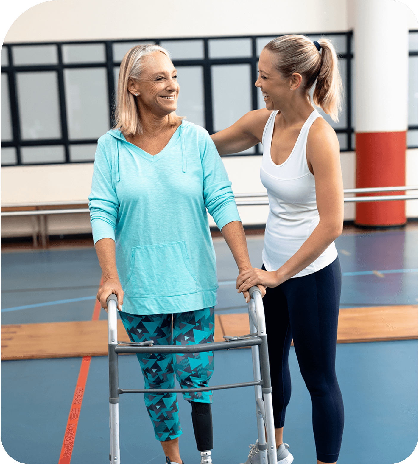Woman helping patient use mobility equipment