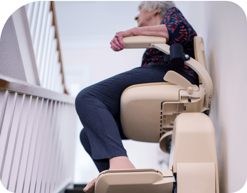Woman on stair lift