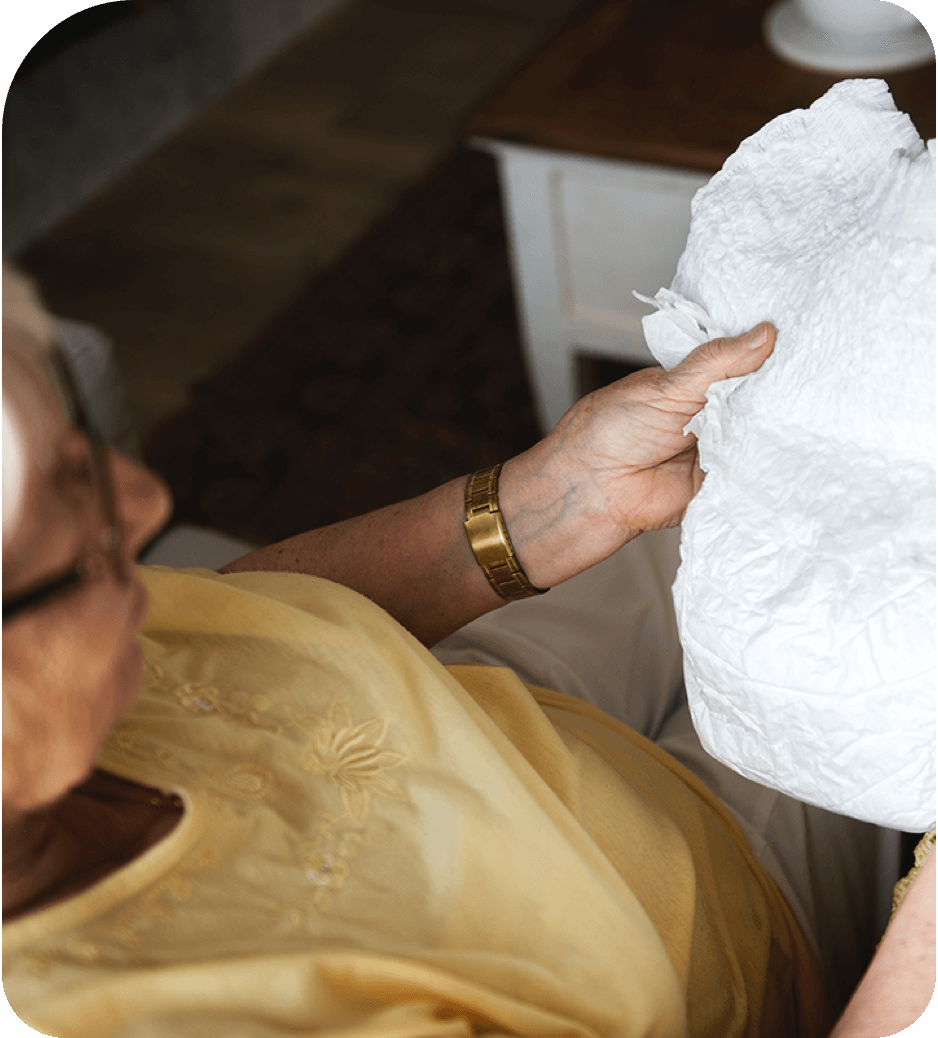 Elderly woman holding incontinence product