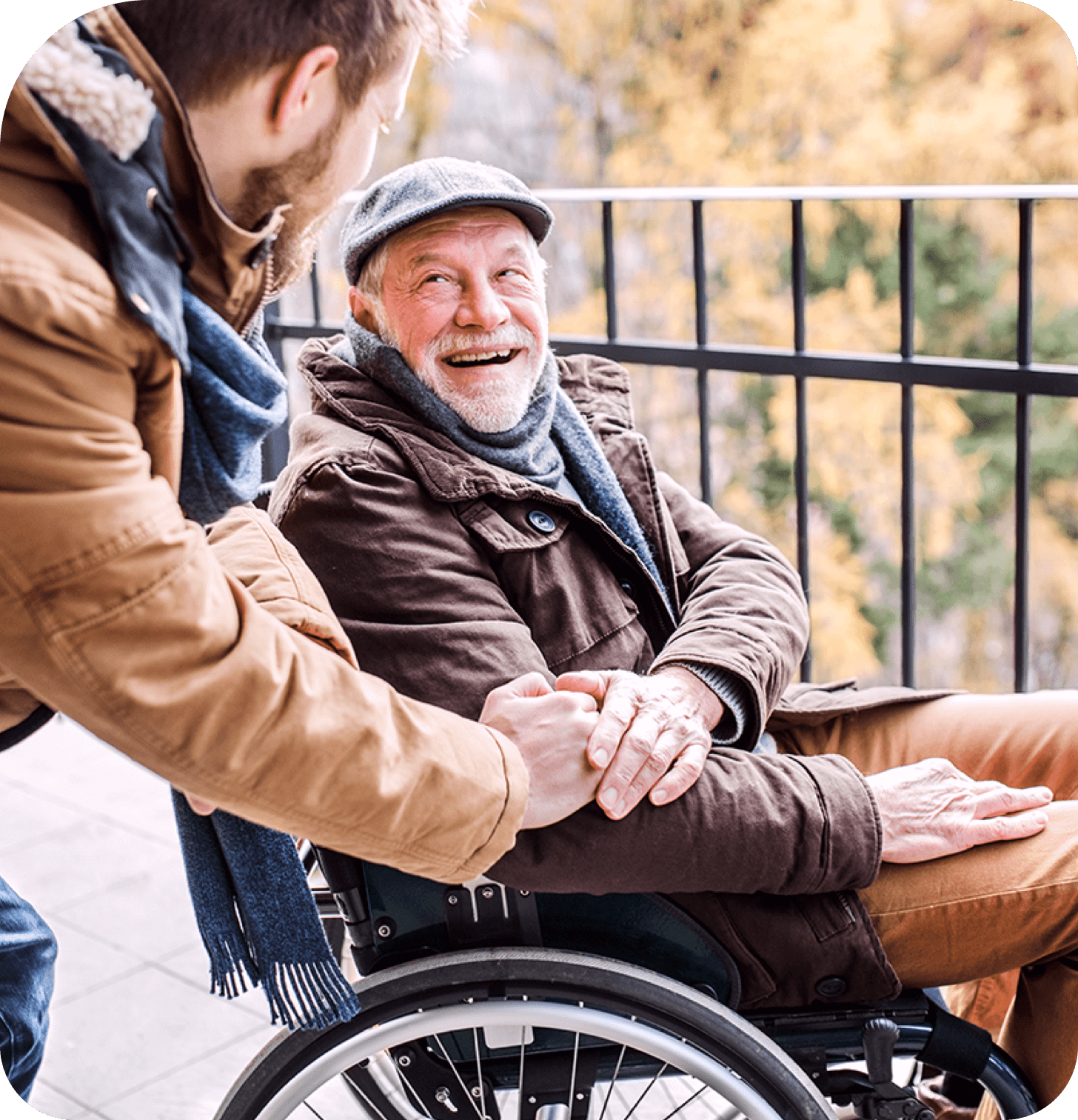 Young man helping elderly man in long term care