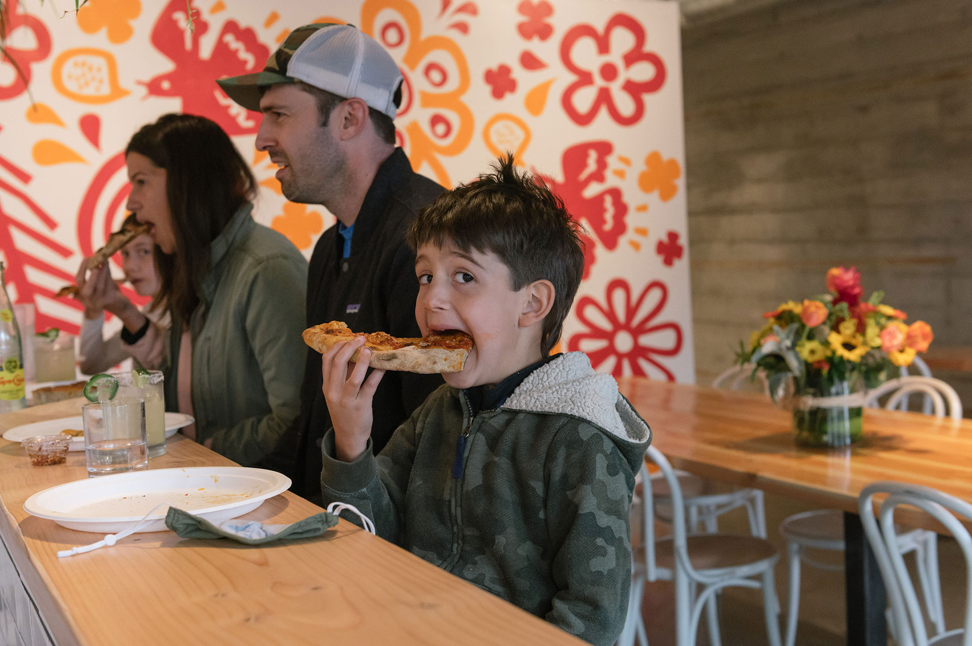 pizza-thief-boy-eating-pizza-slice