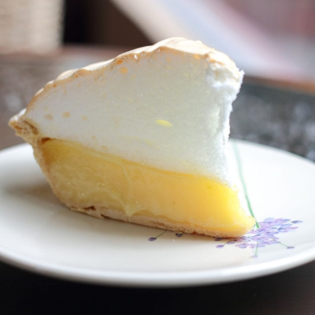 Slice of Lemon Custard Topped with Meringue Topping