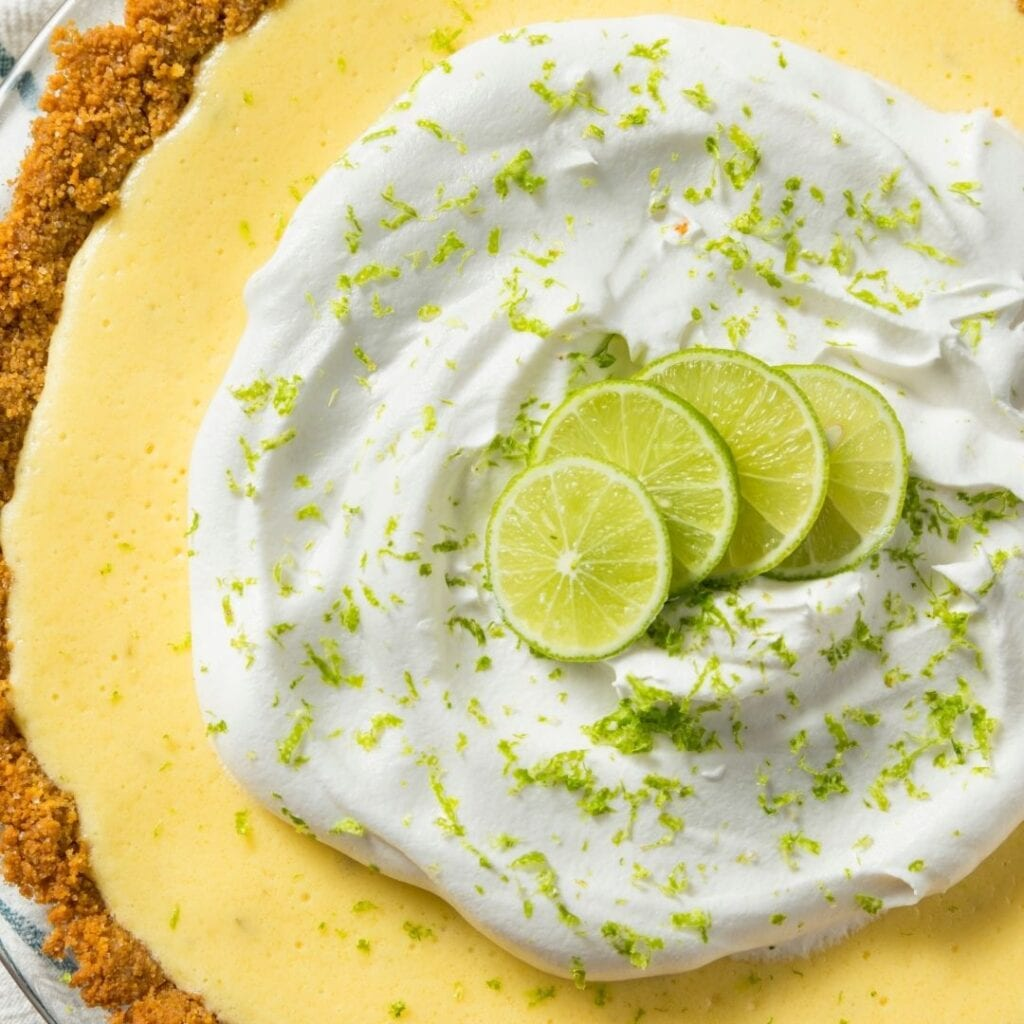 Top View of Pie with Whipping Cream and Lime Zest Garnish