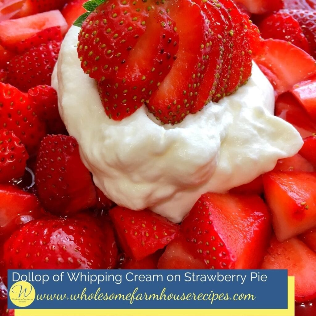 Dollop of Whipping Cream on Strawberry Pie
