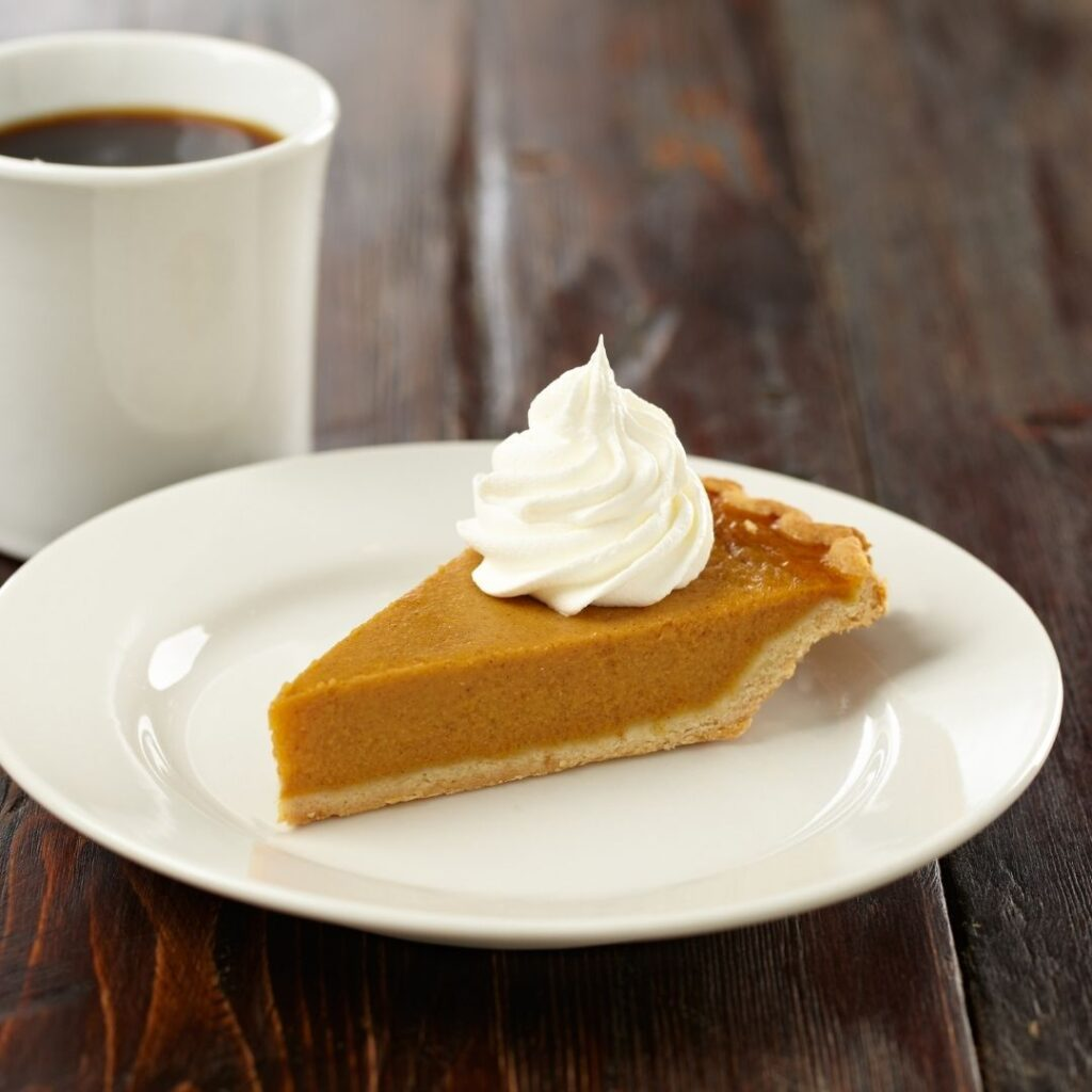 Slice of Pie with Whipped Topping and Cup of Coffee
