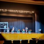 Students rehearsing play on stage