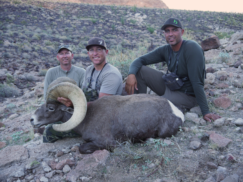 Jay Scott, Hunter Haynes & Craig Steele pose for one final image with this majestic bighorn ram.