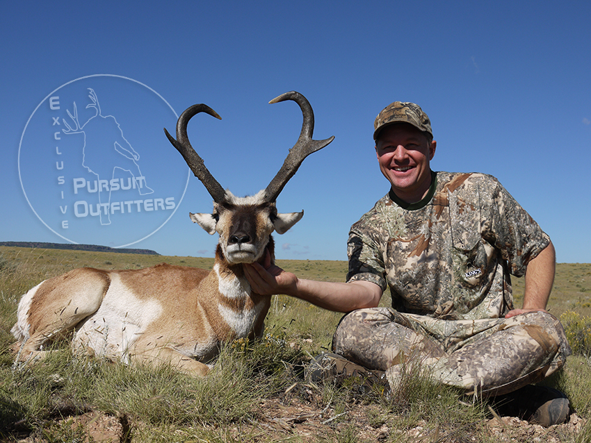 """Ty Nuessle with his beautiful buck called """"the Heart buck""""."""