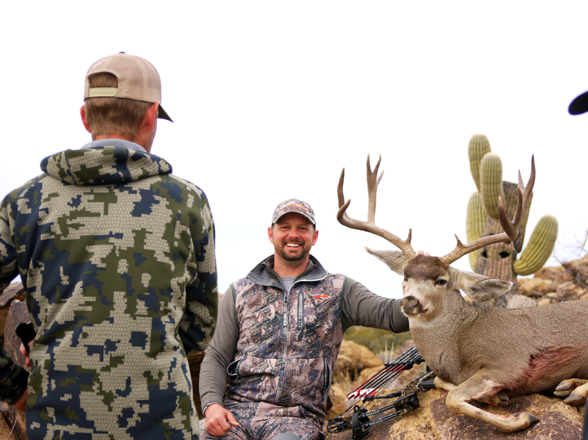 All smiles after taking a big old Arizona Archery Mule Deer with Exclusive Pursuit Outfitters.