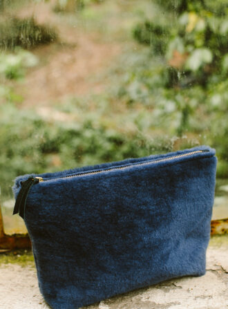 primecut blue shearling clutch