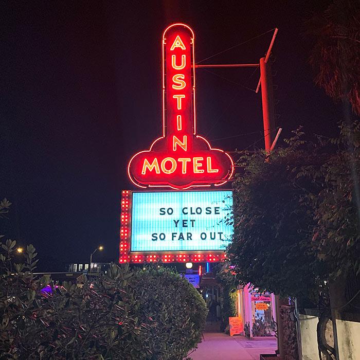 austin motel sign at night phallic