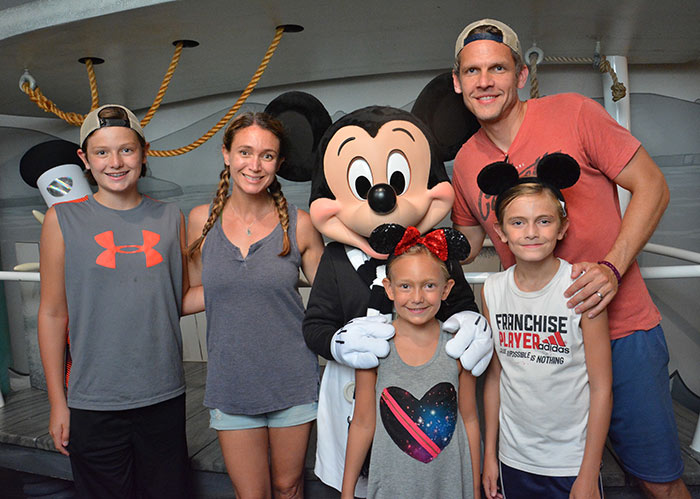 Family with Mickey in Disneyland