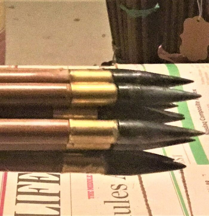 12 matched black arrows ready to shoot