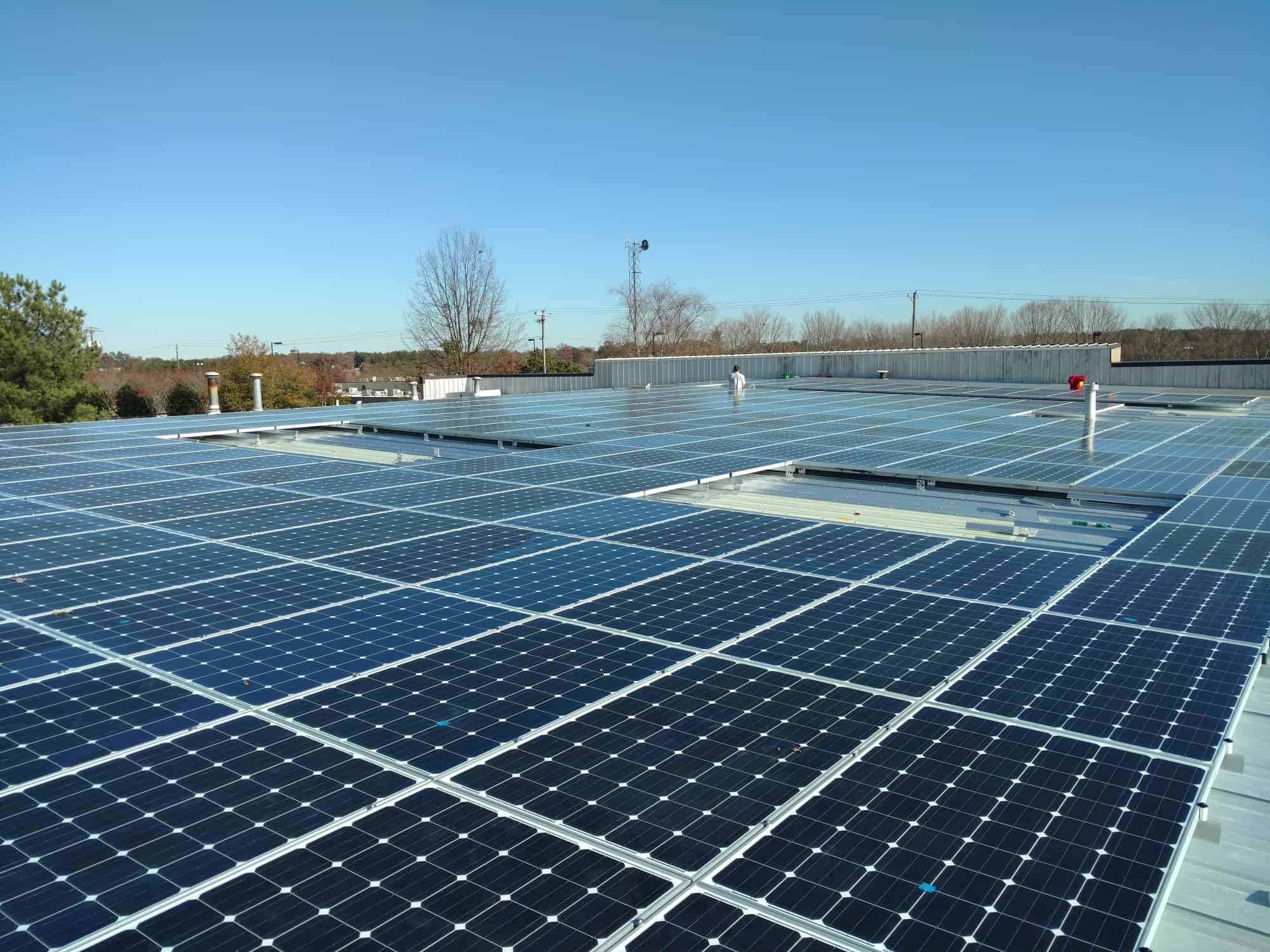 Commercial metal rooftop solar panel installation