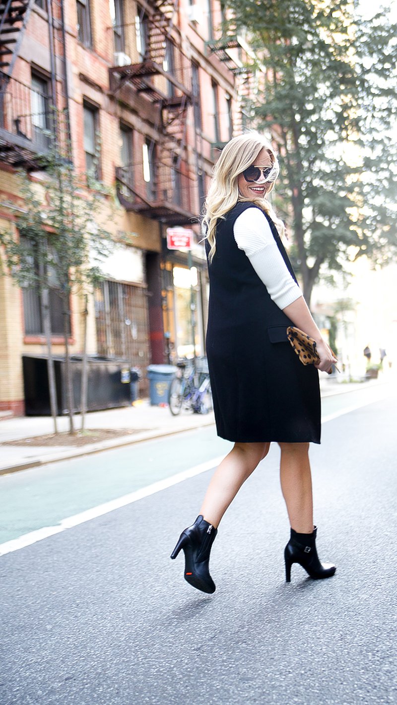 black sleeveless trench and black rockport booties