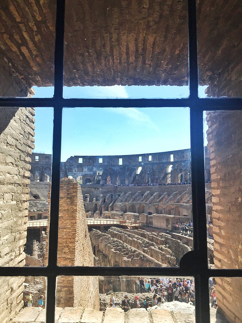 window peeking into the coliseum