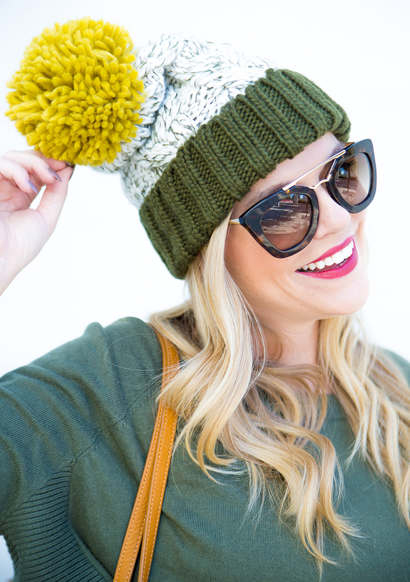 olive and mustard pom pom beanie, olive sweater, cognac gigi new york tote