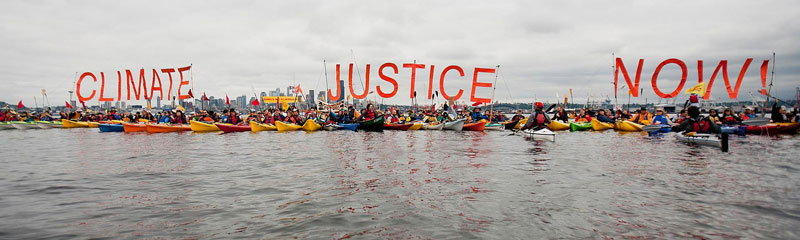Direct actions like the Paddle in Seattle climate kayak-tivists help raise awareness and tip public favor against oil projects. Shell recently announced that it was withdrawing plans to drill in the Arctic. Credit: Backbone Campaign.