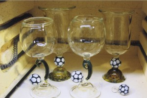 Freehand assorted soccer ball goblet sets and stirrers by Annie.