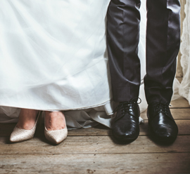 legs of a bride and a groom